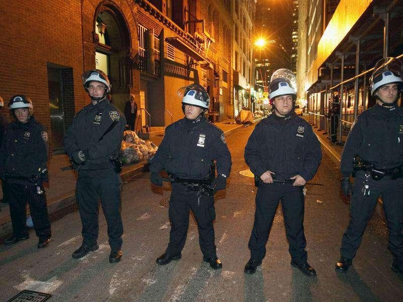 New York Police Department officers block a street after removing members of the Occupy Wall Street movement from Zuccotti Park in New York.