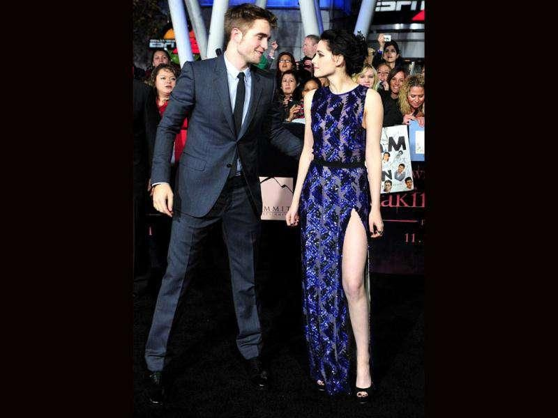 The premiere of The Twilight Saga: Breaking Dawn was a grand affair. Robert Pattinson and Kristen Stewart exuded great off-screen chemistry. Want to know who all marked their presence at the gala event? Here're the pics.