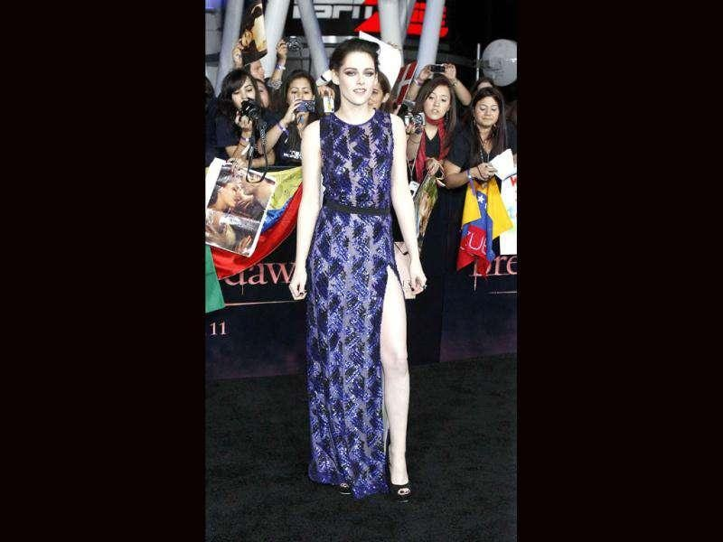 Kristen Stewart looked stunning in a purple see-through outfit as she attended the premiere of The Twilight Saga: Breaking Dawn - Part 1. (Reuters/Mario Anzuoni)