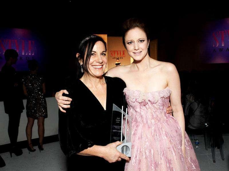 Arianne Phillips (left) was awarded the Costume Designer of the Year prize by rising actor Andrea Riseborough (right).