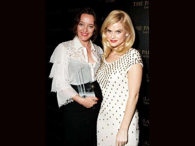 Alice Temperley (left) was presented with the Designer of the Year title by actor Alice Eve (right) at the 2011 Hollywood Style Awards.