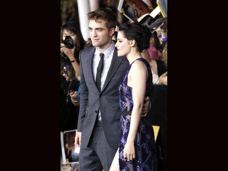 Robert Pattinson and Kristen Stewart look comfortable in each other's company at the premiere of The Twilight Saga: Breaking Dawn - Part 1. (Reuters/Mario Anzuoni)