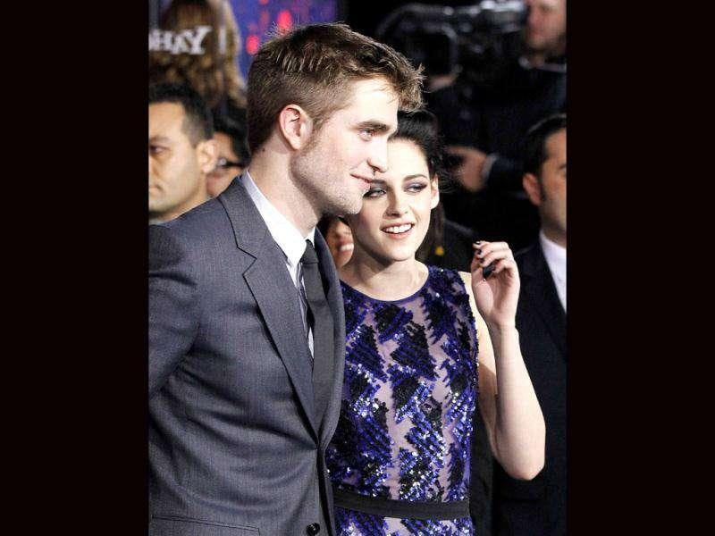 Robert Pattinson and Kristen Stewart pose at the premiere of The Twilight Saga: Breaking Dawn - Part. (Reuters/Mario Anzuoni)
