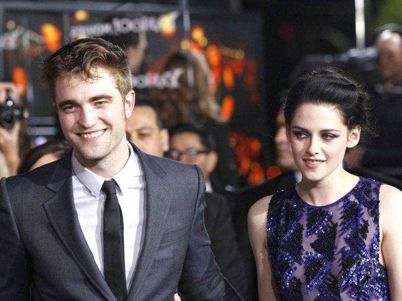 Robert Pattinson and Kristen Stewart pose at the premiere of The Twilight Saga: Breaking Dawn - Part 1. (Reuters/Mario Anzuoni)