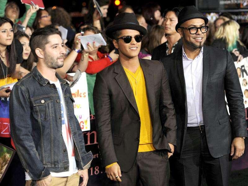 Bruno Mars, center, and guests arrive to the world premiere of The Twilight Saga: Breaking Dawn - Part . (AP Photo/Chris Pizzello)
