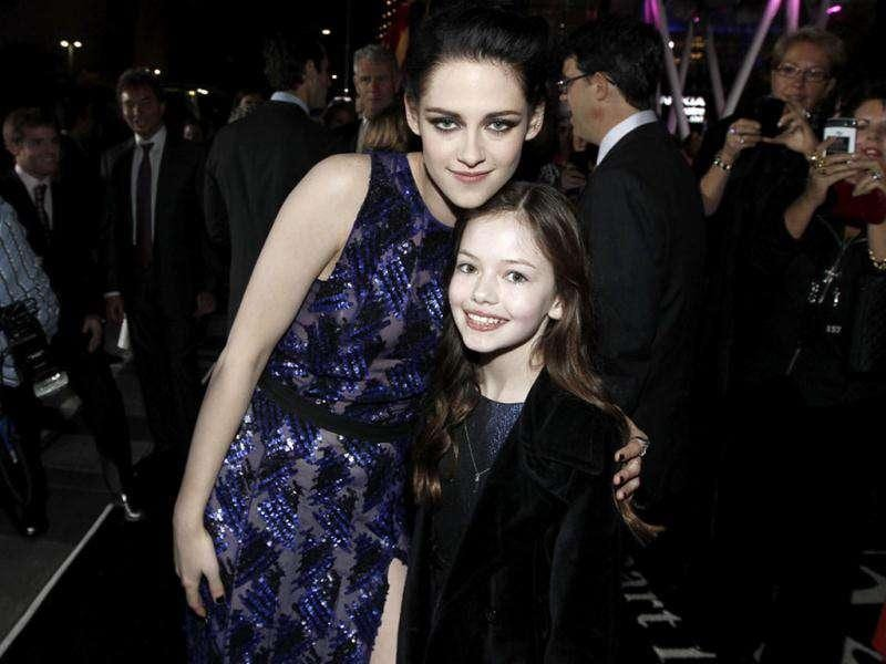 Kristen Stewart, left with her on-screen daughter Mackenzie Foy at the world premiere of The Twilight Saga: Breaking Dawn - Part 1. (AP Photo/Matt Sayles)