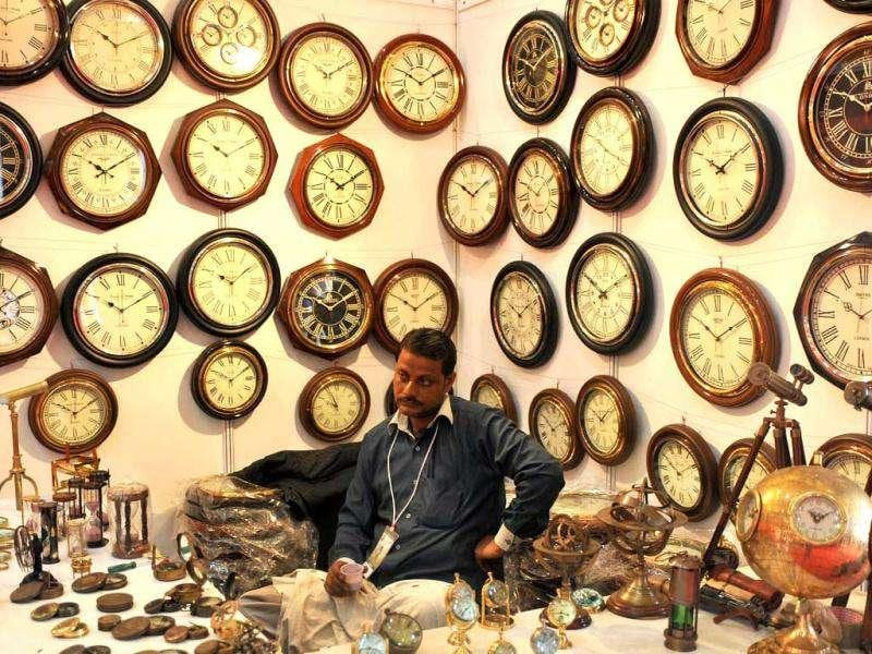An exhibitor waits for customers on a stand during the 2011 India International Trade Fair (IIFT) in New Delhi.