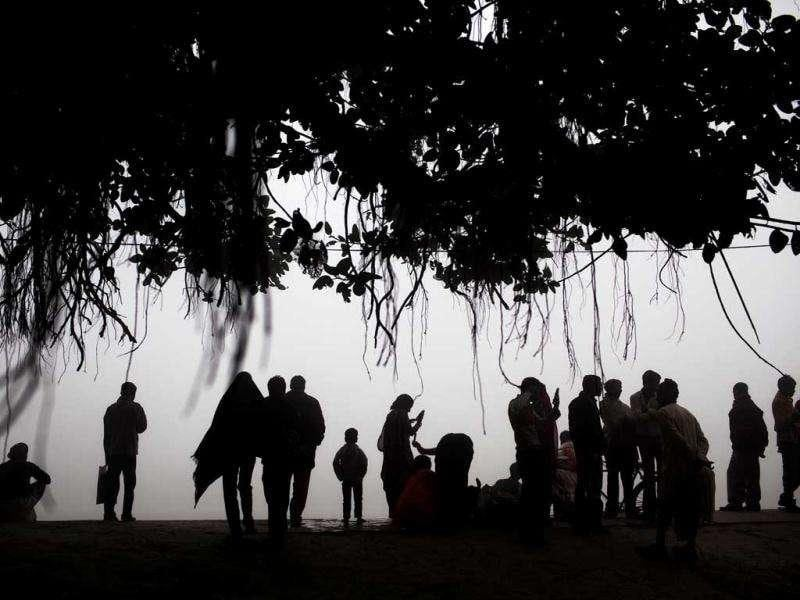 People gather in the morning fog on the banks of the Ganges River at the site of the Sonepur Fair near Patna.