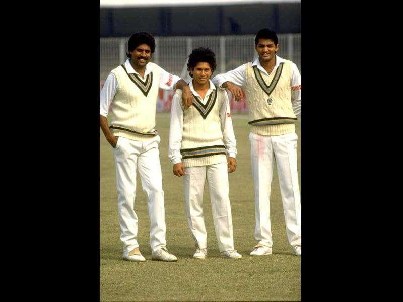Oct 1989: (L-R) Kapil Dev, Sachin Tendulkar and Mohammed Azharuddin all of India pose for the camera before the Test series against Pakistan in India.