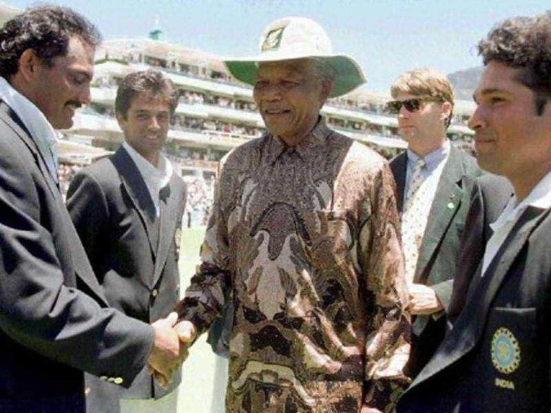 Sachin Tendulkar introduces former South African President Nelson Mandela to Mohammad Azharuddin during the lunch break on the third day of the Second cricket Test between South Africa and India at Newlands, 04 January, 1997.