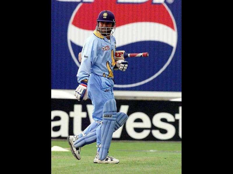 Sachin Tendulkar walks away from the wicket after being caught out at Old Trafford 08 June 1999 during super six match of the Cricket World Cup match in Manchester. He completed 8,000 runs in ODIs in his 217th match at the age of 26 years and 45 days vs Pakistan at Manchester in the World Cup.