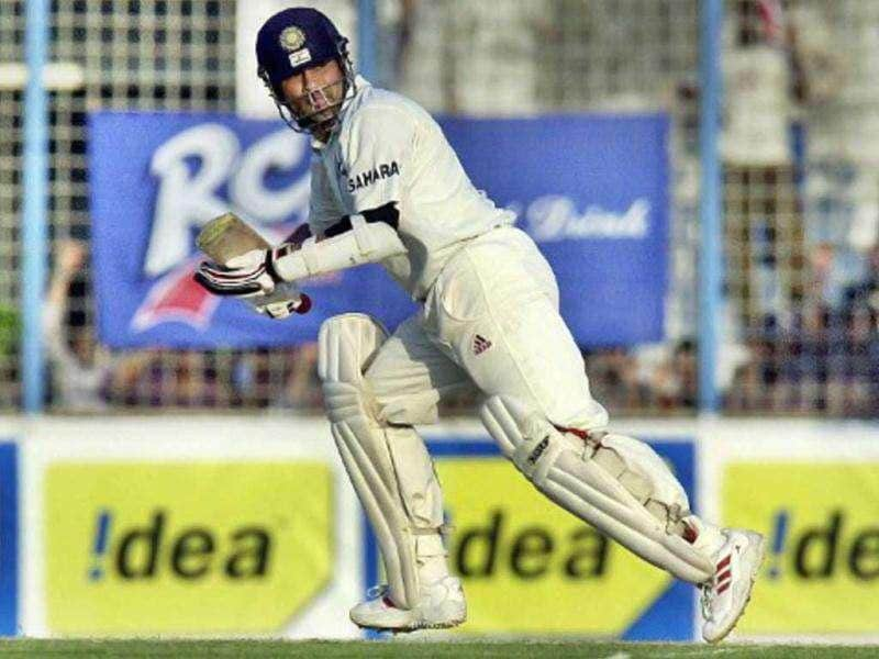 ZIMBABWE, Harare : Indian batsman Sachin Tendulkar celebrates his century against the West Indies 4 July 2001 in Harare. Tendulkar was unbeaten on 122 runs with India winning the sixth match in the triangular series by 6 wickets.