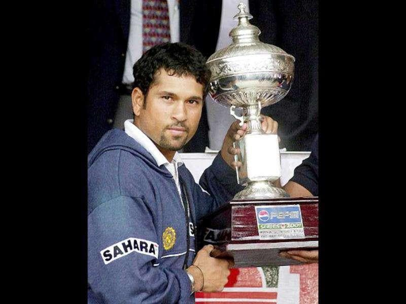 Sachin Tendulkar poses with the Man of the Series trophy after the final Test match between India and England in Bangalore 23 December 2001. The Test match was called off when play could not be resumed for the day due to bad weather conditions. India won the three Test match series by 1-0 with their win in the first Test in Mohali. AFP PHOTO