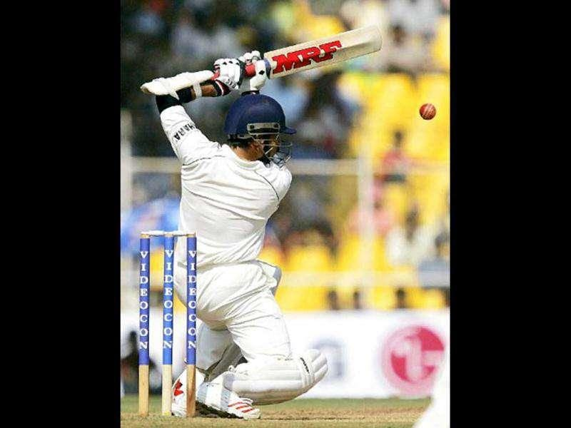 Sachin Tendulkar defends the wicket during the first day of the third and final Test match against Sri Lanka at Sardar Patel Gujarat Stadium in Ahmedabad. He scores a record 35th hundred on the first day of the second Test against Sri Lanka in New Delhi, surpassing Gavaskar's record. AFP PHOTO