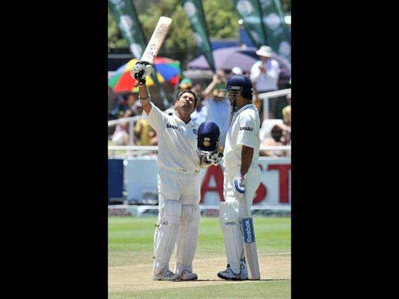 Sachin Tendulkar (L) looks skywards as he celebrates his 51st century during the third day of the third Test match between India and South Africa at the Newlands Stadium in Cape Town on January 4, 2011. AFP PHOTO/ Alexander Joe