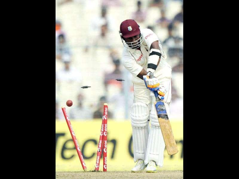 West Indies Darren Bravo is clean bowled during the third day of the second Test cricket match between Indian and West Indies at The Eden Gardens in Kolkata.