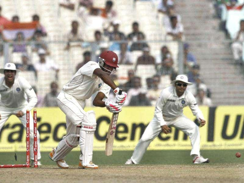 West Indian batsman Darren Bravo is bowled out by Umesh Yadav during the third day of their second cricket Test match against India, in Kolkata.
