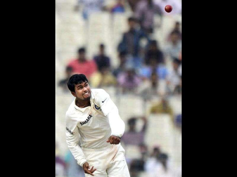 Pragyan Ojha bowls during the third day of the second Test cricket match between Indian and West Indies at the Eden Gardens in Kolkata.