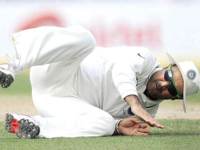 Virender Sehwag dives to stop a ball during the third day of the second Test cricket match between Indian and West Indies at the Eden Gardens in Kolkata.