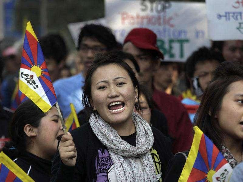 An exile Tibetan shouts slogans against the Chinese government during a march in New Delhi.