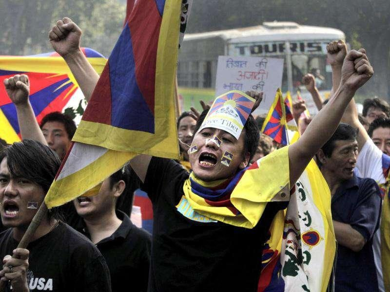 Exile Tibetans shout slogans against the Chinese government during a march in New Delhi.