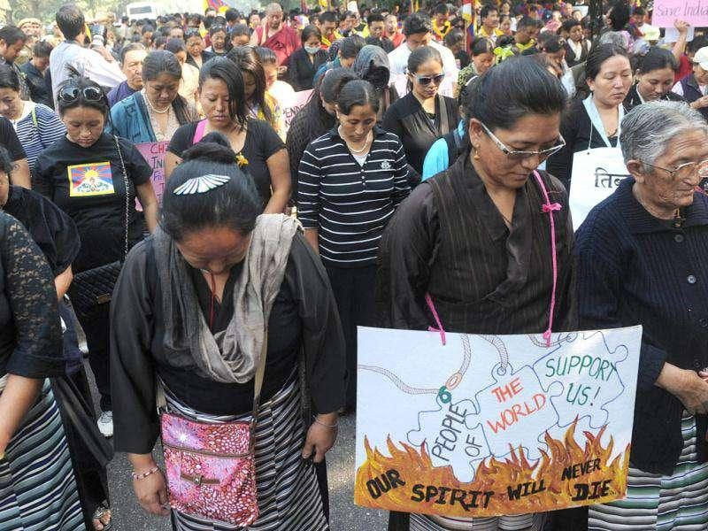 Tibetan protesters pray during a Tibetan people's solidarity movement rally near the Chinese embassy in New Delhi.
