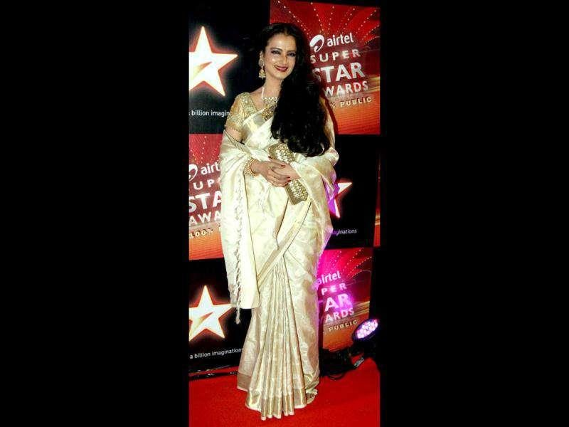 No surpises! Rekha once again in an off-white and golden silk saree.