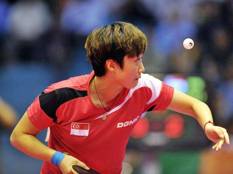 Singaporean Feng Tian Wei eyes the ball as she plays against Singaporea Li Siyun Isabelle in their women's singles table tennis during the 26th Southeast Asian Games in Jakarta.