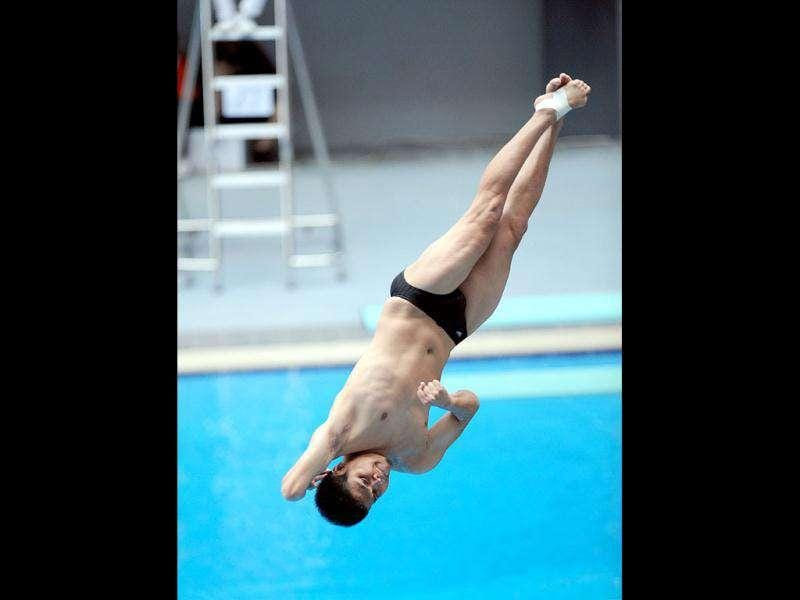 Suchart Pichi of Thailand competes in the men's diving 3 meters final at the 26th Southeast Asian Games (SEAGAMES) in Palembang, Sumatra province.