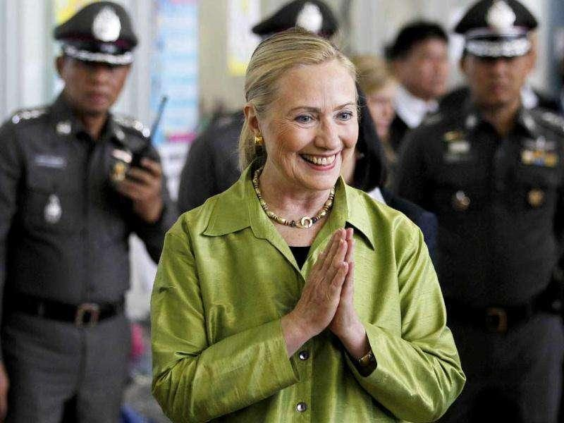 US secretary of state Hillary Clinton greets in the traditional Thai way as she visits the collective centre for people evacuated from flooded areas in Bangkok