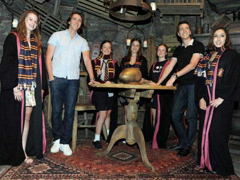 British twins James Phelps (2nd L) and Oliver Phelps (2nd R), who play Fred and George Weasley from the Harry Potter film series, pose with Harry Potter fans during the opening of the Harry Potter exhibition at the Powerhouse museum in Sydney.