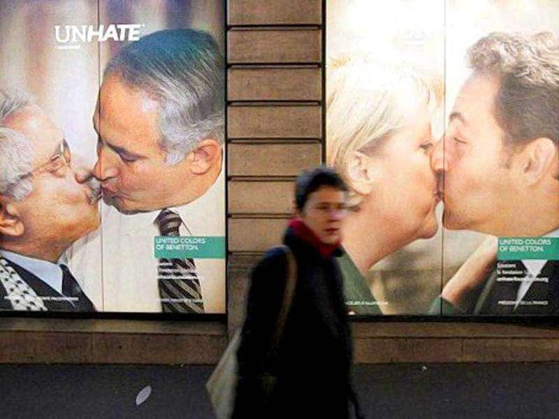 A Benetton clothing store window covered by posters as part of the launch of a provocative publicity campaign with photo montages showing several personnalities like Palestinian leader Mahmud Abbas kissing Israeli Prime Minister Benyamin Netanyahu on the lips or French president Nicolas Sarkozy kissing German chancellor Angela Merkel.
