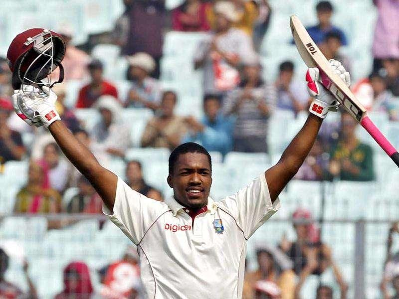 West Indies' Darren Bravo celebrates his century on the fourth day of their second Test cricket match against India in Kolkata.