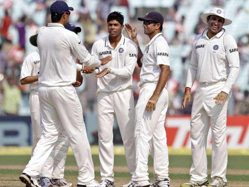 Umesh Yadav, third right, is congratulated by Rahul Dravid, second right, and others after taking the wicket of West Indies Batsman Shivnarin Chanderpaul, unseen, during fourth day of second cricket Test match in Kolkata.