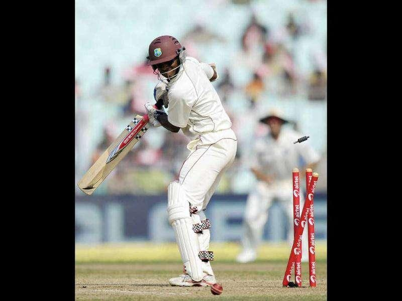 West Indies Shivnarine Chanderpaul looks on as he is clean bowled during the fourth day of the second Test cricket match between Indian and West Indies at the Eden Gardens in Kolkata.