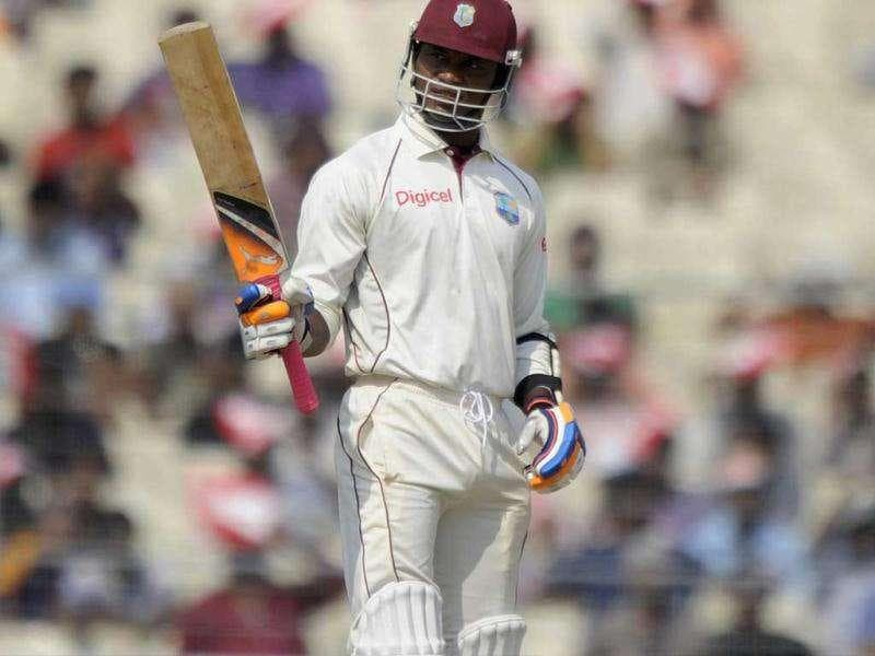 West Indies Marlon Samuels celebrates after scoring a half-century during the fourth day of the second Test cricket match between Indian and West Indies at the Eden Gardens in Kolkata.