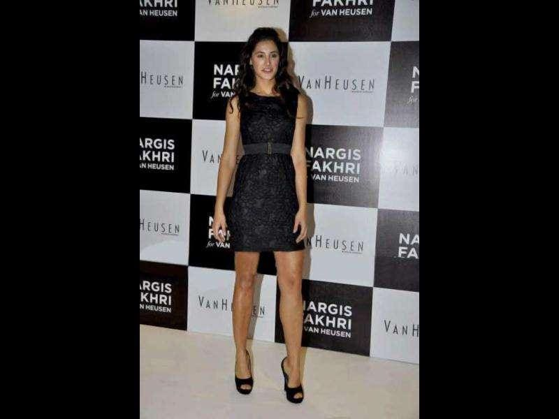 Nargis looks absolutely ravishing in a haute couture black dress.
