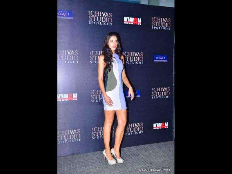 Nargis flaunts her enviable body at the Chivas party.