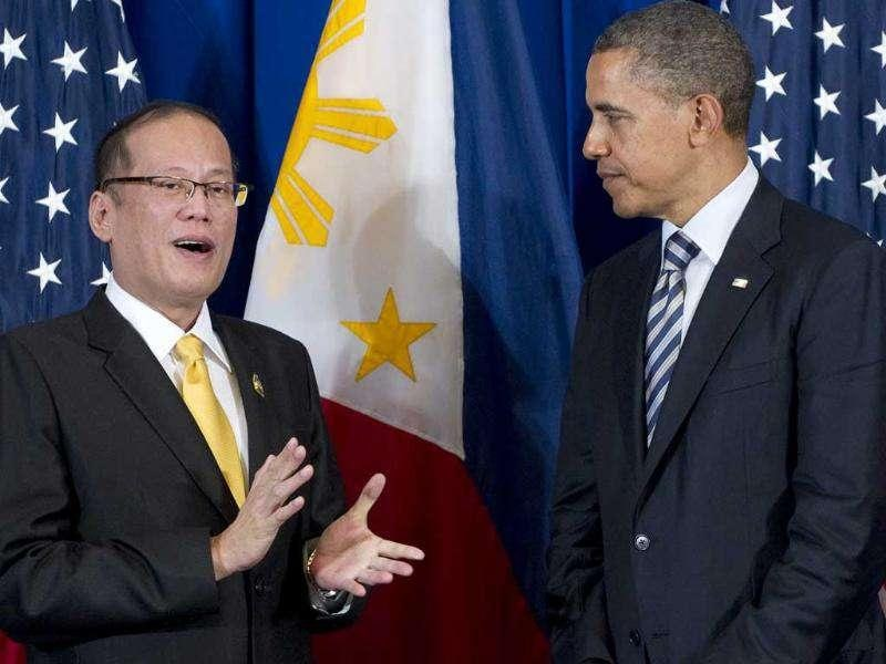 US President Barack Obama listens to Philippine President Benigno Aquino (L) during their meeting on the sidelines of the Association of Southeast Asian Nations (ASEAN) and East Asia summits in Nusa Dua in Bali.
