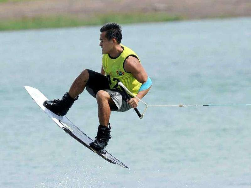 Andy Huang of Singapore competes in the men's wakeboard team overall category semi-finals at the 26th Southeast Asian Games (SEAGAMES) in Palembang, Sumatra province.