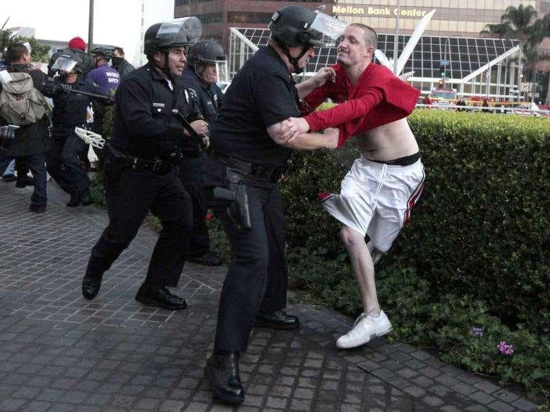 Los Angeles Police Department (LAPD) officers arrest a man at an Occupy LA protest outside a Bank of America office in Los Angeles, California.