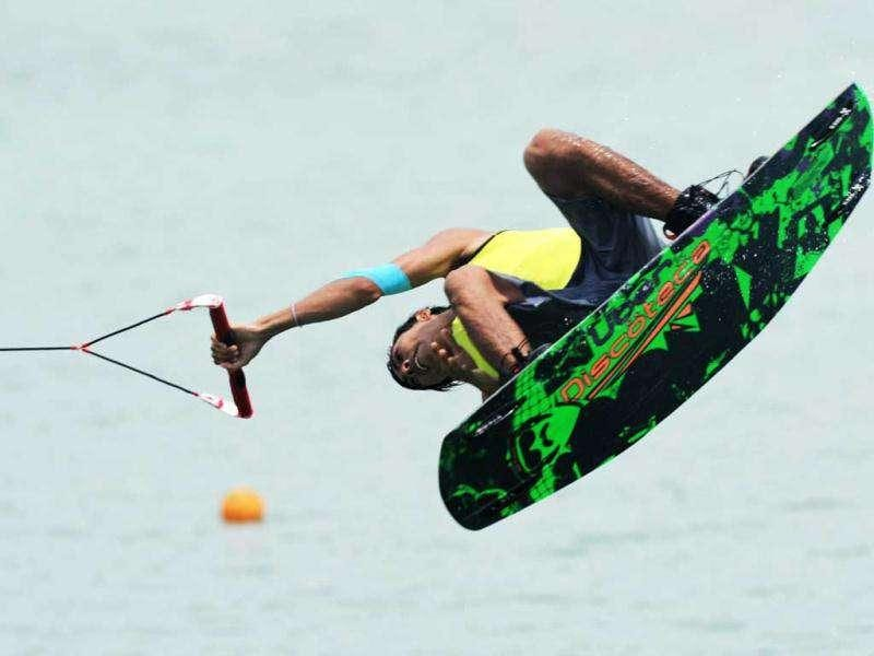 Christian Mathew of Singapore competes in the men's wakeboard team overall finals at the 26th Southeast Asian Games in Palembang, Sumatra province.