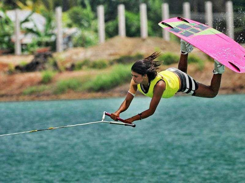 Sasha Christian of Singapore competes in the women's wakeboard team overall finals at the 26th Southeast Asian Games in Palembang, Sumatra province.