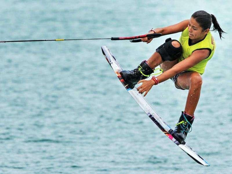 Samantha Bermudez of the Philippines competes in the women's wakeboard team overall finals at the 26th Southeast Asian Games in Palembang, Sumatra province.