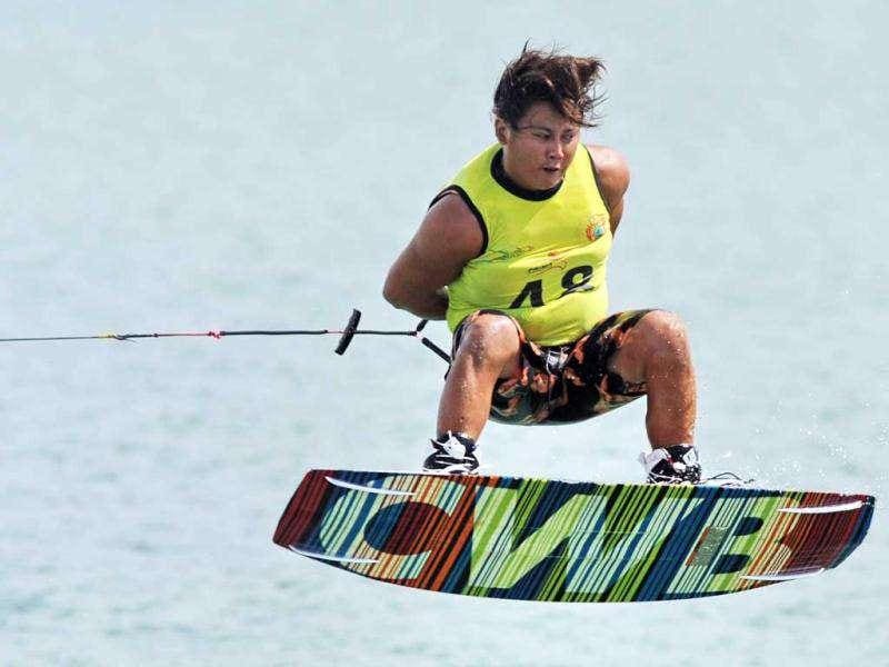 Number one seed Padiwat Jaemjan of Thailand competes in the men's wakeboard team overall category semi-finals at the 26th Southeast Asian Games in Palembang, Sumatra province.