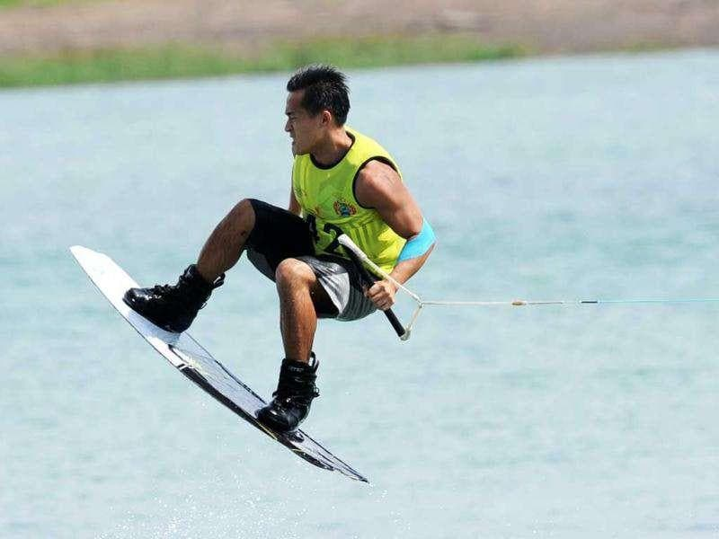 Andy Huang of Singapore competes in the men's wakeboard team overall category semi-finals at the 26th Southeast Asian Games in Palembang, Sumatra province.