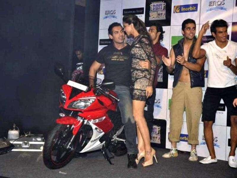 John seems to be showing off his biking prowess to Deepika. (Photo courtesy: Fashionista, Pinkvilla)