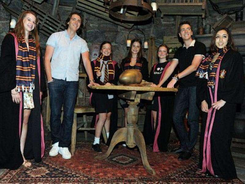 James Phelps (2nd L) and Oliver Phelps (2nd R), who play Fred and George Weasley from the Harry Potter film series, pose with Potter fans during the opening of the Harry Potter exhibition at the Powerhouse Museum in Sydney.