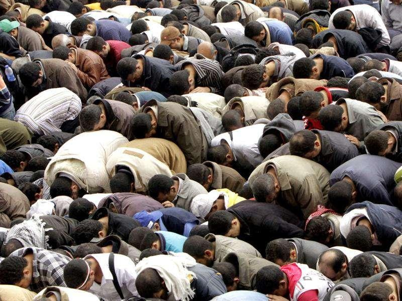 Thousands of Egyptians perform Friday prayers during a rally in Cairo's Tahrir square, Egypt in a protest against what they say are attempts by the country's military rulers to reinforce their powers.