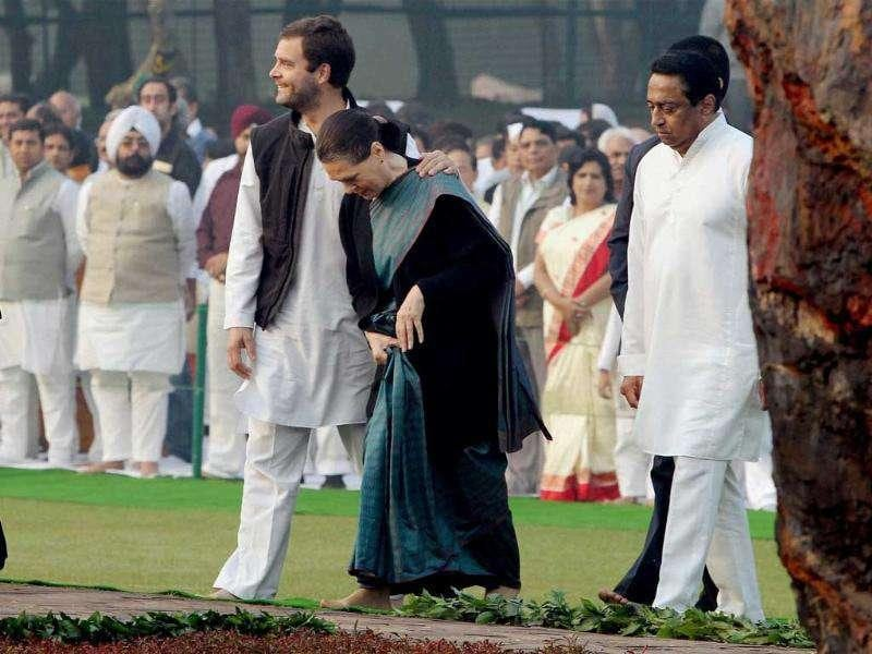 Congress president Sonia Gandhi and her son Rahul Gandhi arrive for paying tributes to Indira Gandhi on her 94th birth anniversary at her memorial Shakti Sthal in New Delhi.